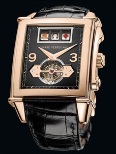 """Girard-Perregaux's Vintage 1945 Jackpot Tourbillon features a fully functioning slot machine (minus, of course, an actual jackpot). The watch's slot machine recreates the first slot machine, the """"Liberty Bell,"""" featuring the same symbols on its spinning gold reels: spades, hearts, diamonds, horseshoes and bells."""