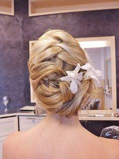 loose braid add flowers for a wedding on the beach