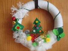 Fun Yarn Wreath with A Christmas Tree and Gifts by astrausa