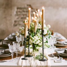 Beautiful shot for a European countryside wedding. Rustic fixtures, vintage flatware, and stone walls. Get the same look without the melt and mess with Candle Impressions LED tapers.