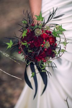 Red Riding Hood Noir Wedding Inspiration Shoot // gorgeous deep red, black and green bridal bouquet // photo: Nerinna Studios