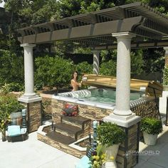Ugly overall design but a good reminder thatg gazebo posts could also match deck and house post rockwork