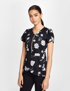 The Tulip Top in Midnight Floral is a contemporary addition to women& medical scrub outfits. Shop Jaanuu for scrubs, lab coats and other medical apparel. Scrubs Outfit, Scrubs Uniform, Doctor Scrubs, Lab Coats, Medical Uniforms, Professional Wear, Uniform Design, Medical Scrubs, Work Attire