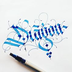 """Dragon"" intricate blue hand lettering and calligraphy"