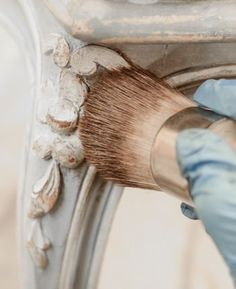 Antique wood furniture by adding layers of paint and stain to achieve a grunge patina. Distress it by removing finish to simulate years of wear.: