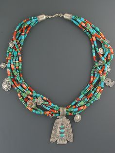 Multiple shades of Turquoise with other colored beads make this classic southwest necklace soar just like the Thunderbird pendant hanging at the bottom.
