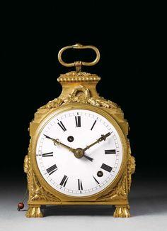 """c1810-20 OFFIZIERSUHR TRAVEL CLOCK, Empire, the movement by COURVOISIER ET COMP (Louis Courvoisier, La Chaux-de-Fonds 1758-1832 Paris), France circa 1810/20. Matte and polished gilt bronze. Enamel dial, 3 hands, verge escapement with 4/4 striking """"Grande Sonnerie"""" and alarm, trip repeat. 12x10x15 cm. Sold for CHF 7 500 (hammer price)"""