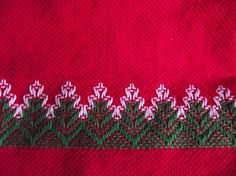 This vintage red hand towel is decorated with Swedish Weave, a technique where the thread does not penetrate the cloth, but is carefully woven amongst the raised threads. Therefore, the back of the towel is solid red, with only a few threads visible where the embroidery thread was started. The design is done in green and white. There is a smaller design stitched above the fringe on the back of the towel. These type of towels are very good for drying crystal and china or can be used as a…