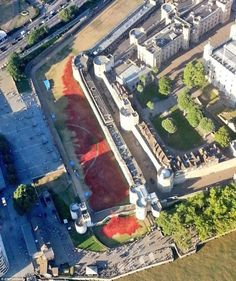 Breathtaking: The Metropolitan Police helicopter captures from above how the sea of red poppies has been spread across the Tower of London's grounds