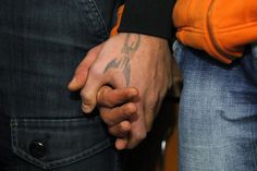 February 28, 2013 Inmates hold hands during a therapeutic exercise at the Jilava prison near Bucharest, Romania. A conference on drug abuse in prisons and its relation to the rise of HIV-AIDS was organized for inmates who are part of a project in which they receive help to overcome their addictions. Bogdan Cristel/Reuters
