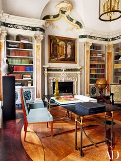 The library's inlaid floor was inspired by the 1734 Jacques de Lajoue painting above the mantel | archdigest.com