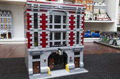 Been wanting to do this for a while. The goals were to turn the GB Firehouse Headquarters set into the Modular style buildings and away from the dollhouse...