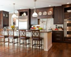 My kitchen inspiration: dark cabinets, white subway tile... beautiful!
