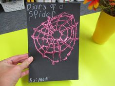 """What Happens in First Grade:  Read """"Diary of a Spider"""" by Doreen Cronin.  Then students pretend they are a spider and write a journal entry each day telling about a different adventure.  (On Monday I went to California.)  For web cover, draw circles on paper with glue.  Use a popsicle stick to pull glue from center out.  Sprinkle with glitter."""