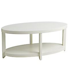 Meyers Coffee Table - Antique White Pier One  Nice open option for a small space.  The oval shape will make it easy to move around.