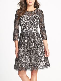 This romantic lace dress with scalloped edges enhances a feminine charm while keeping a classic silhouette.