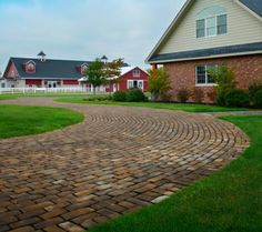 We like the classic look of this driveway, it goes well with the look of the home and stable. Driveway Design, Driveway Pavers, Outdoor Paving, Paving Ideas, Design Basics, Driveways, Walkways, Outdoor Spaces, Living Spaces
