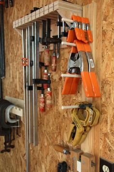 Overhead clamp storage in wasted space --- that's a great idea if you don't use them often, or have a basement workshop. Description from pinterest.com. I searched for this on bing.com/images