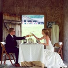 The newlyweds share a moment to themselves in the boathouse. This barn wedding is rustic chic, gingham & burlap perfection!