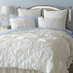 Our ruched ivory bedding gathers crisp 100% cotton in a pattern of flowers on a field of diamonds. Inside ties at all four corners keep your duvet from shifting, while shams feature tie backs and decorative welting. The ruche is on.