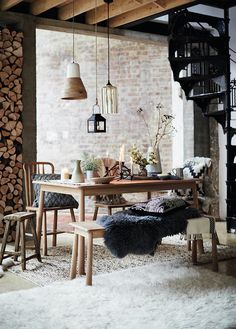 Can you feel the hygge? A dining setup with lit candles, fire logs in a stack and an organic vibe. Image by DFS Furniture. Inside A House, Deco Boheme, Hygge Home, Scandinavian Interior Design, Dining Nook, Cabin Interiors, Cabin Design, Modern House Plans, Decoration