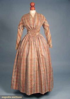 1840s Madras Day Dress - Plaid of brown, blue, tan, white, and green; fan front gathered bodice; tight sleeves w/scalloped caps; and brass hook & eye back closure.
