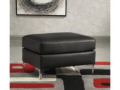 Fall in love with the Tensas Black Ottoman by Signature Design by Ashley at Direct Value Furniture proudly serving Roscoe, IL and surrounding areas for over 10 years! Penthouse Suite, Black Ottoman, Minimalist Chic, Upholstered Ottoman, Recycled Furniture, Pent House, Signature Design, Foam Cushions, Light In The Dark