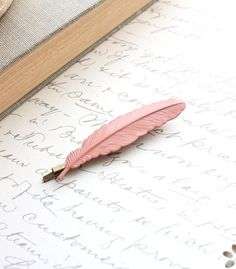 Feather bobbypin, Etsy listing at https://www.etsy.com/listing/119295947/feather-bobby-pin-pink-feather-peach