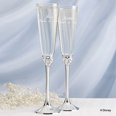 Dreams Come True Flutes - Perfect for a fairytale themed wedding are these personalized flutes with silver-plated stems featuring rhinestone studded hearts.  See these flutes and many other invitations & accessories at www.printedcreations.carlsoncraft.com/Weddings/Disney-Fairy-Tale-Weddings/ZB-ZBK20777-Dreams-Come-True-Flutes.pro.  #fairytalewedding