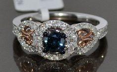 blue diamond rose gold engagement ring,