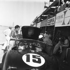 Carroll Shelby looks over Phil Hill's Cobra at Sebring, 1964.