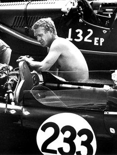 Steve McQueen in a spot where he was very comfortable, surrounded by race cars. This weekend, at the Pebble Beach auto auctions, McQueen's Ferrari 275GB/4 will cross the block..it's expected to bring between $US8.0-$12.0 million and set a new record for that model Ferrari. He was the real thing....