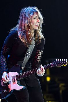 "Nancy Wilson with the ""Blue Guitar. Female Guitarist, Female Singers, Nancy Wilson Heart, Heavy Metal, Musica Metal, Bass, Guitar Girl, Blue Guitar, Women Of Rock"
