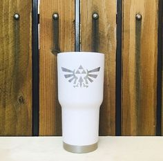 Custom Laser etched Triforce of Power RTIC Tumbler  We promise all your friends will be asking you where got that awesome tumbler.  Why get a laser etch tumbler over a screen printed one? We custom laser etch each tumbler with a special chemical that burns the design permanently in black. This means you can wash it over and over and the logo will NEVER rub off. Screen printing can fade and chip off over time. Laser etching will be there for life!  About RTIC Tumblers: RTIC Tumblers are…