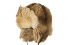 The legendary Mühlbauer hat Igor is a fur hat perfect for a grand winter entrance. Igor is made of coyote fur, a wild, long-haired fur with reddish, yellow and grey natural colors. Sometimes the fur is veiled in a black hairline along the back. This fur hat has a stately volume and therefore warms exceptionally well. The earpieces can be tied up at the top of the crown with a ribbon. Igor is worn by men and women. Natural Colors, The Crown, Hairline, Entrance, Winter Hats, Ribbon, Fur, Colours, Long Hair Styles