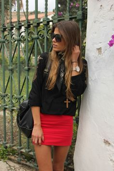 Red skirt with a black shirt and ombre hair