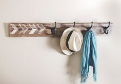 Sometimes simplicity is best when it comes to decorating your home and this coat rack with a modern arrow geometric design can offer just the right amount of modern rustic feel without going overboard. This wooden coat rack is made from hardwood and can be stained with the color of your choosing while adding a reclaimed wood look. The color featured in the picture is Early American. The four cast iron hooks and long length of this wall mounted coat rack makes it a sturdy place to hang your…