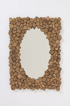 Make a picture frame or a mirror... could use slices of corks!