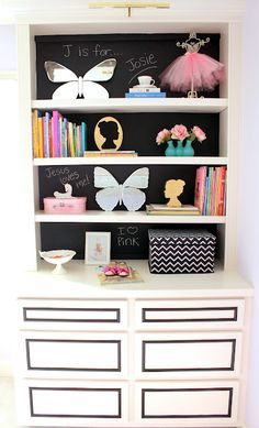 white bookcase with backing painted with chalkboard paint
