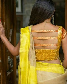 Buy House Of Blouse Yellow and orange brocade boat neck blouse online in India at best price.Shimmer and shine, this dual toned brocade blouse is to go an extra mile in the oomph factor. Blouse Back Neck Designs, New Saree Blouse Designs, Choli Blouse Design, Blouse Designs Catalogue, Simple Blouse Designs, Stylish Blouse Design, Brocade Blouse Designs, Designer Blouse Patterns, Blouse Styles