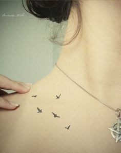small Bird tattoo on the shoulder