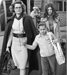 graceandfamily:  Princess Grace keeps a hand on daughter Stephanie as daughter Caroline and Grace's mother, Margaret, (in background) follow at Philadelphia International Airport, 1973. (SAM PSORAS / Philadelphia Daily News, File)  1973