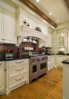 Great Kitchen Cabinet Decoration with Rustic Brick Backsplash : Hard Wood Floor Feat Bricks Backsplash Plus White Kitchen Cabinet Paint Also Red Flower Decoration
