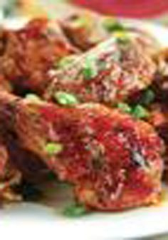 Spicy Sesame Buffalo Chicken Wings -- Consider it a good thing if no one is talking while eating these spicy, sweet and garlicky wings. This Asian twist on the classic will be your new game-night appetizer recipe.