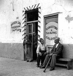 "a ""Haircutting & Shaving Saloon"" in the Bo-Kaap. 1943 #hairstylesinafrica"