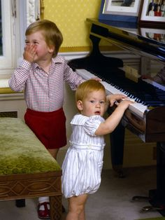 Prince William and his brother, Prince Harry, play the piano at home in Kensington Palace.