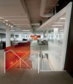 Office & Workspace: Stairwell With Glass Panel And White Ceiling Track Lamp Also Orange Work Stations: Chic and Modern Office Ideas Concept with Colorful Theme