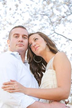 Tennessee bride and groom posing by the trees for their engagement photos, by Nashville wedding photography company Candice Jones Photograph...