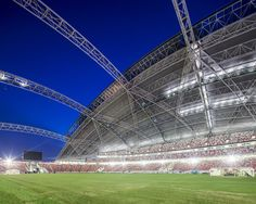 """interior ... Singapore SportsHub (aka """"The National Stadium)   Architects: DP Architects & Arup Associates    Location: Singapore Sports Hub, 397718, Singapore   Photographs: Courtesy of DP Architects    Asia's first integrated sports, leisure, entertainment, & lifestyle destination; & the largest dome structure in the world. all around the outside (The Social Plinth) & the inside (The Sports Promenade) are things such as playgrounds, sand volleyball courts, swimming pools, climbing walls…"""