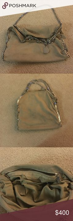 Stella McCartney fold over Falabella purse in grey Fold over Fallabella by Stella McCartney.  Grey/ beige color that goes with everything.  There is a small (less than half inch) pen mark on the exterior and a place where the thread unraveled near the chain (see photo).  Otherwise it's in great condition. Stella McCartney Bags Shoulder Bags
